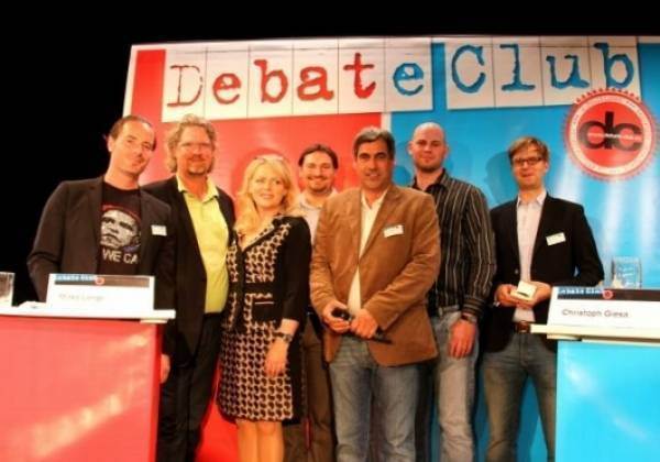 The evening's debaters and host at Schwabing's TamS Theater